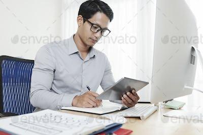 Serious entrepreneur reading report