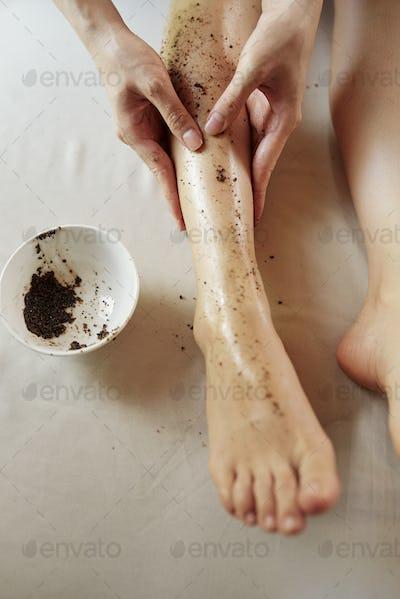 Woman scrubbing her legs