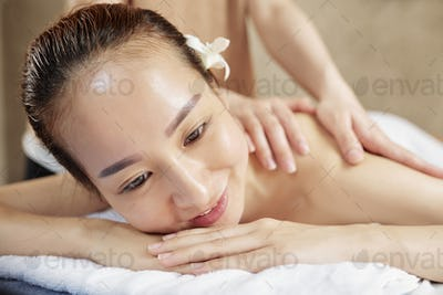 Asian woman enjoying back massage