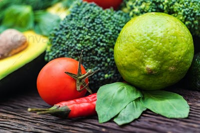 Fresh vegetables, lime and avocado close