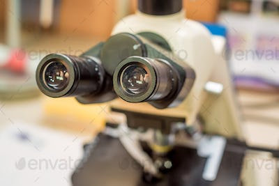 Closeup of ocular lens microscope in laboratory