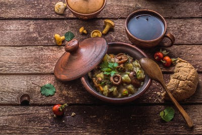 Potato and mushrooms ragout in a pot, copy space