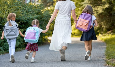 Parent and pupils are going to school