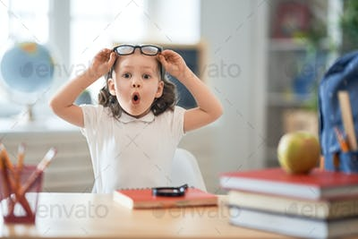 Kid is learning in class