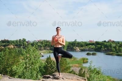 Performing tree pose on quarry