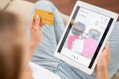 Young shopaholic going to look through new casualwear collection in online shop
