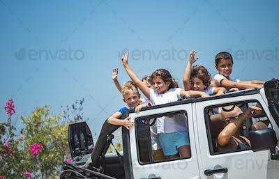 Happy children in the car