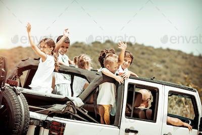 Happy kids enjoying road trip