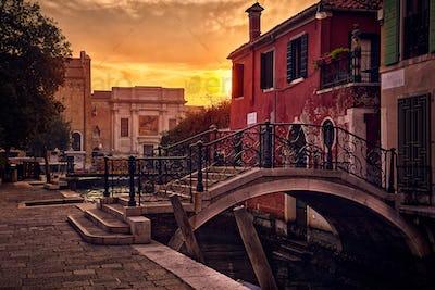 Little bridge in Venice backlit by the setting sun