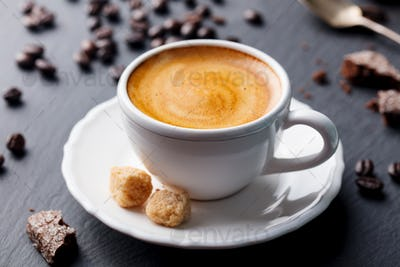 Coffee Espresso in White Cup on Black Slate Background.
