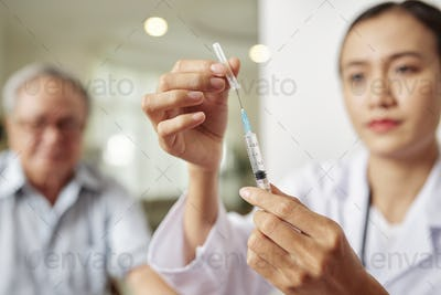 Doctor with syringe at hospital