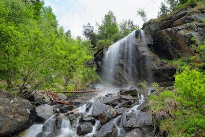 Lillaz waterfall among rocks, Aosta Valley, Italy