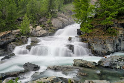 Lillaz waterfall among rocks, Aosta Valley, Italy