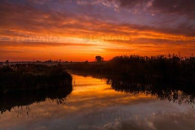 Amazing purple sunrise over rural river