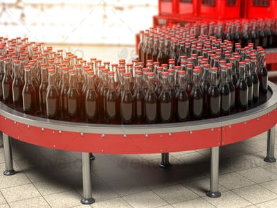Production of soda bverages or cola. A row of bottles on conveyo