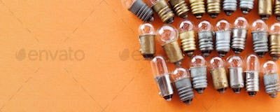 Light bulbs with textured gold bronze and silver surface.