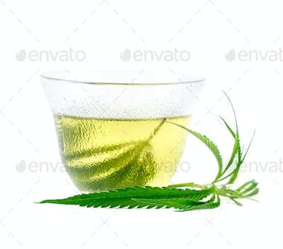 marijuana herbal tea served in glass teacup