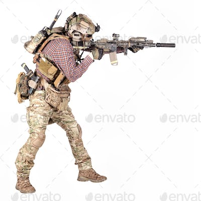 Airsoft player aiming service rifle studio shoot
