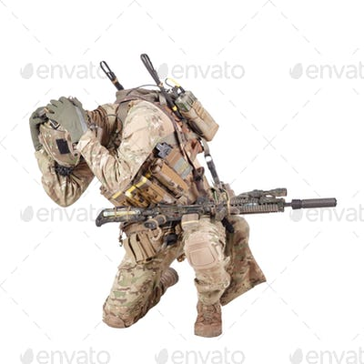 Infantryman hiding from explosion studio shoot isolated on white