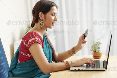 Indian woman shopping online