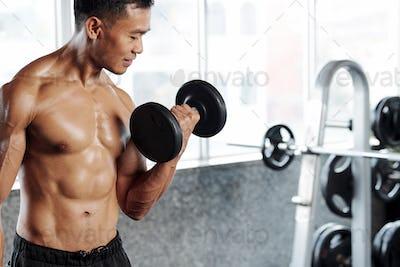 Sportsman working on biceps