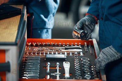 Repairman taking out tools