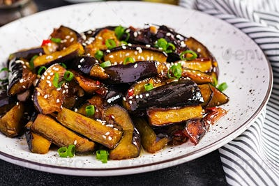 Hot spicy stew eggplant in Korean style with green onion. Aubergine saute. Vegan food.