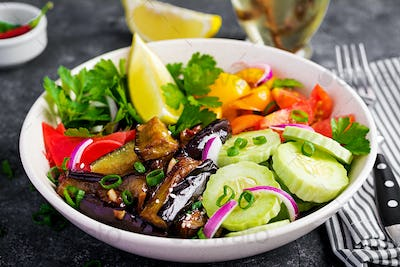 Salad fresh raw vegetables - armenian cucumber, tomatoes, paprika, parsley, red onion