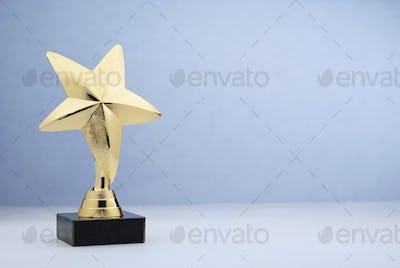 Star shaped golden trophy for rewarding in contest