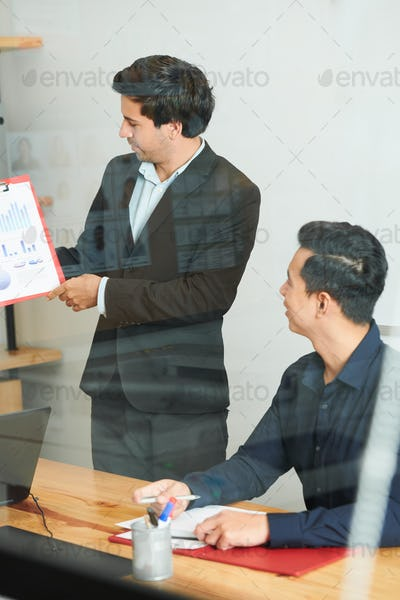 Businessman with report at meeting
