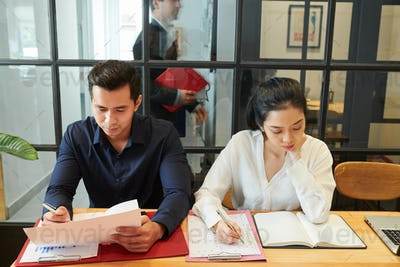 Business colleagues working at office
