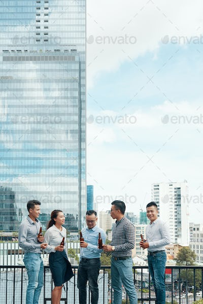 Business people drinking beer outdoors