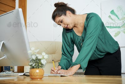 Businesswoman busy with work at office