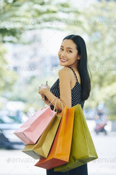 Happy woman after shopping