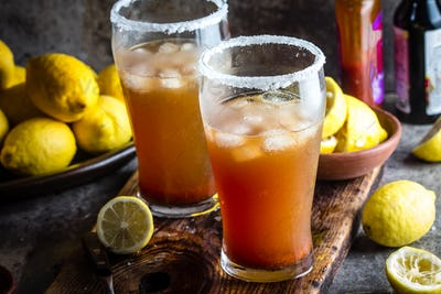 Mexican Michelada. Traditional spicy refreshing beer drink with lemon juice, salt