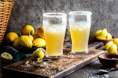 Traditional Latin American chilean mexican refreshing beer drink with lemon, salt and ice.