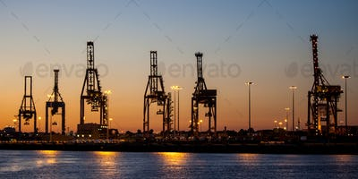 Cargo Cranes At Dusk