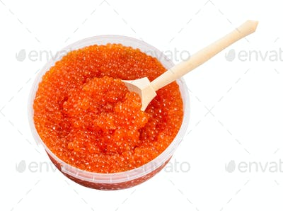 plastic container with red caviar and big spoon