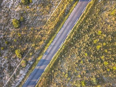 Road through barren landscape