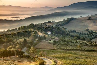 Tuscany foggy hills panorama view