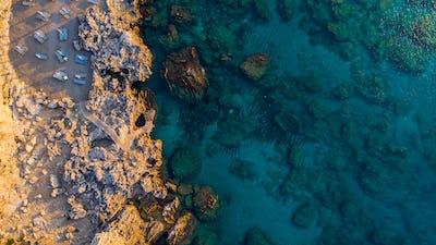 Secret Beach on Rocky Shore and Blue Waters, Greek Island, Drone