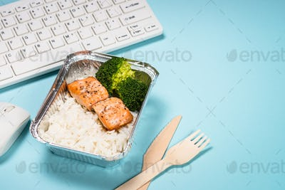 Food delivery concept - healthy lunch on office table