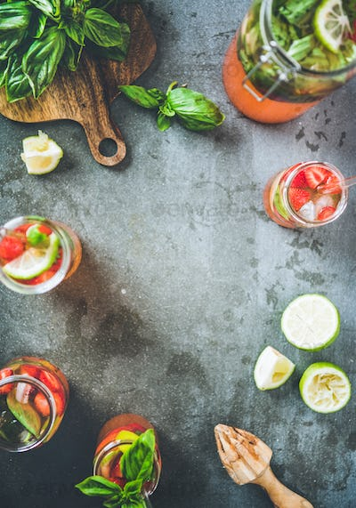 Fresh lemonade or iced-tea with strawberry and basil, copy space