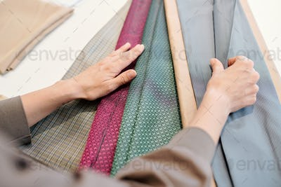 Female designer looking through textiles for new collection