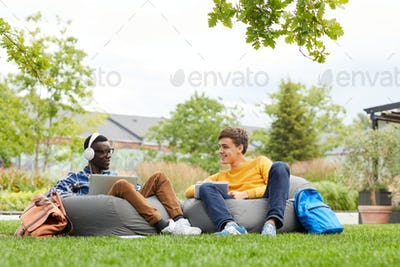 Two Students Chilling Outdoors on Campus