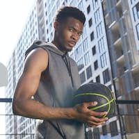 Handsome African Sportsman with Basketball Ball