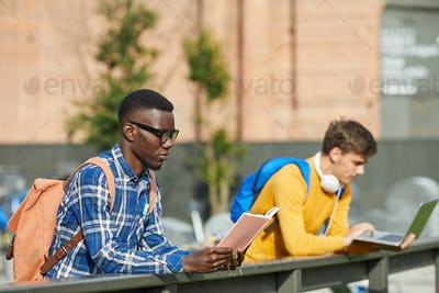 College Students reading Outdoors
