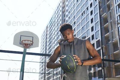 Handsome African Sportsman in Basketball Court