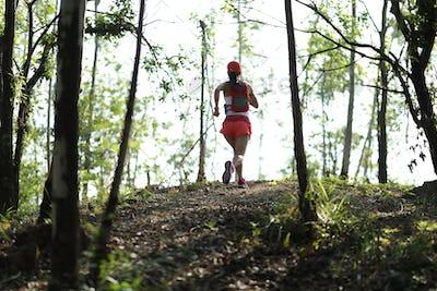 Ultra marathon runner running in forest
