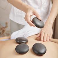 Woman receving hot stone massage